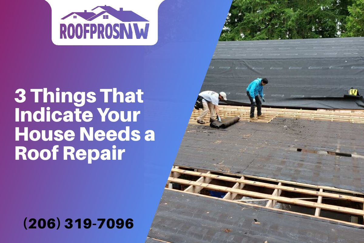 Two men on top of a roof preparing a new roof replacement.